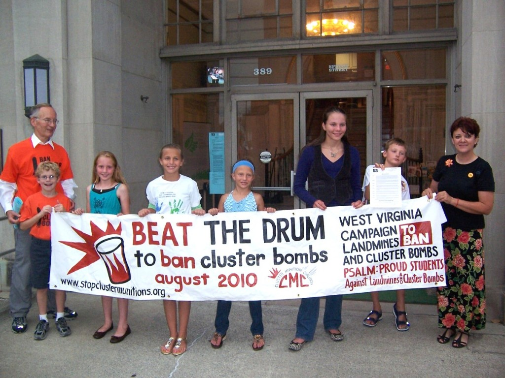 "Students hold ""Beat the Drum"" banner in front of Morgantown City Hall"