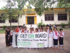 Children in Laos with sign painted by PSALM students