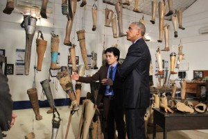During President Obama's historic visit to Laos, he met with cluster bomb victims and toured the Cooperative Orthotic and Prosthetic Enterprise (COPE) visitors' centre in Vientiane with its operations manager Soksai Sengvongkham, September 2016.  © 2016 Khamchanh Phetsouphan